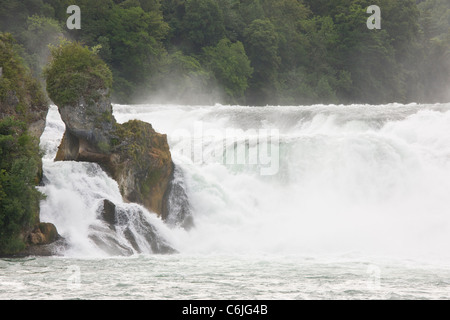 Tourist boat and visitors at Rhine Falls (Rheinfall) at Schaffhausen - largest in Europe - Stock Photo