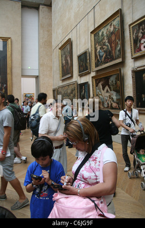 tourists at the louvre museum in paris france - Stock Photo