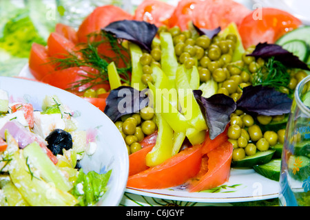 Fresh salad with tomatoes, peas, cucumber, basil, green pepper - Stock Photo