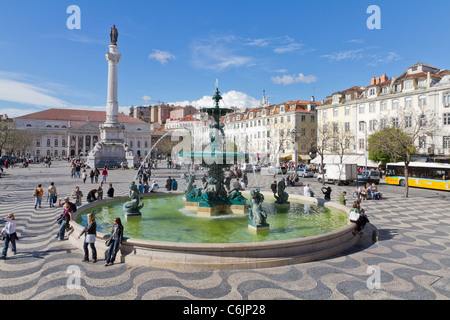 Rossio square the liveliest placa in Lisbon with wavy cobble stone pattern Portugal - Stock Photo