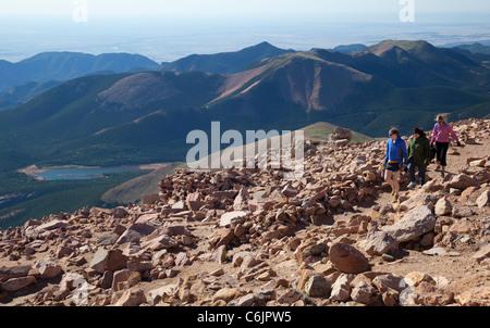 Colorado Springs, Colorado - Hikers on Barr Trail near the summit of Pikes Peak. - Stock Photo