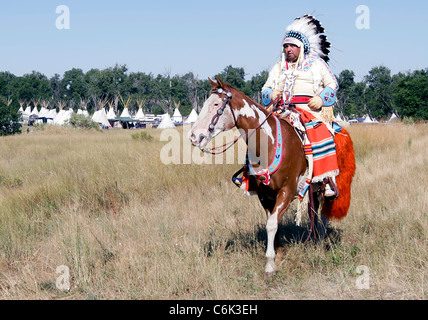 Indian chief in a parade held on the Crow Reservation, Montana, during the annual Crow Fair - Stock Photo