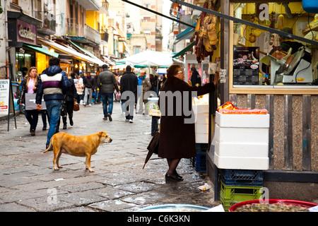 The street market of Mercato di Porta Nolana in Naples Italy. - Stock Photo