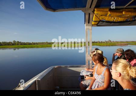 Yellow Water Cruise Boat, Yellow Water Billabong, Kakadu National Park, Northern Territory, Australia - Stock Photo