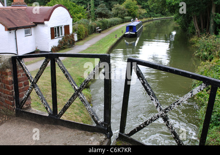 Split bridge on the Stratford Canal near Dick`s Lane Lock, Warwickshire, England, UK - Stock Photo