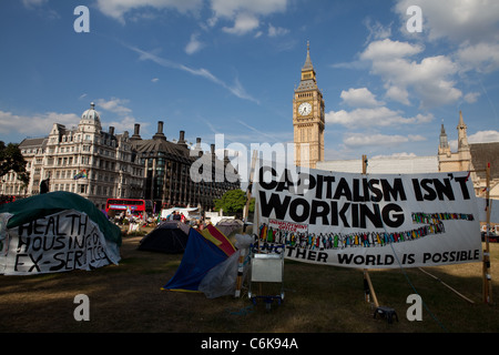 View of Democracy Village peace camp with banners, tents and Big Ben in the background. - Stock Photo