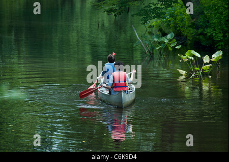 Teens canoeing, New Jersey, USA - Stock Photo