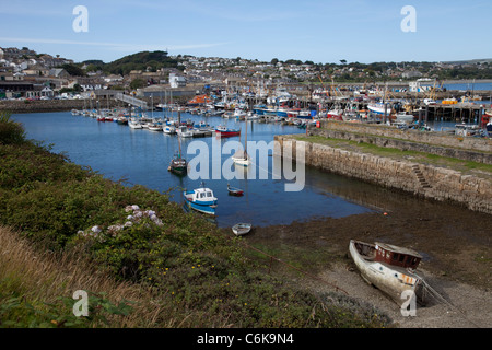 Fishing boats and pleasure craft Newlyn harbour with town in background Cornwall UK - Stock Photo