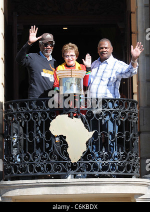 Morgan Freeman adding his handprint to the Mandela Legacy Canvas with Western Cape Premier Helen Zille and Cape - Stock Photo
