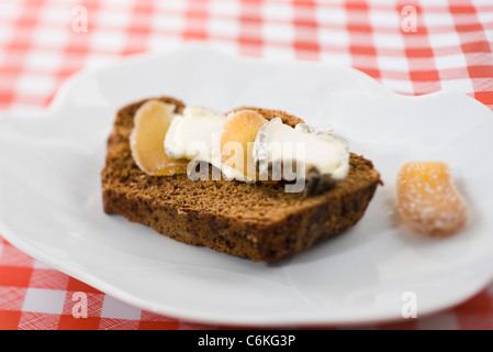 Sliced gingerbread with goat cheese and candied ginger - Stock Photo