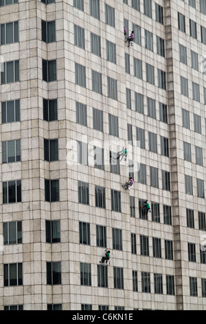 Window Cleaner at Exchange Tower, Bangkok, Thailand - Stock Photo