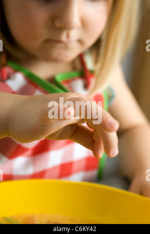 Little girl preparing food, cropped - Stock Photo