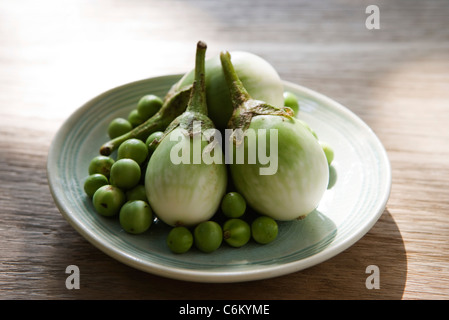 Thai eggplants and limes, ingredients for green curry chicken - Stock Photo