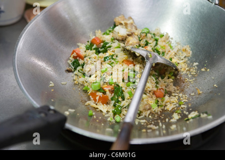 Fried rice with chicken or pork - Stock Photo
