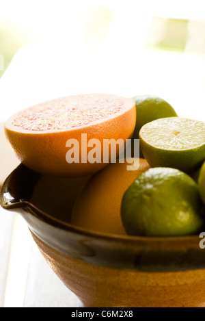 Sliced grapefruit, limes