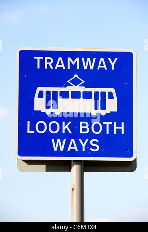 Sign reading 'Tramway, Look both ways' - Stock Photo