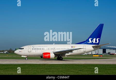 Scandinavian Airlines (SAS) aircraft prepares for take off from Manchester Airport, England - Stock Photo