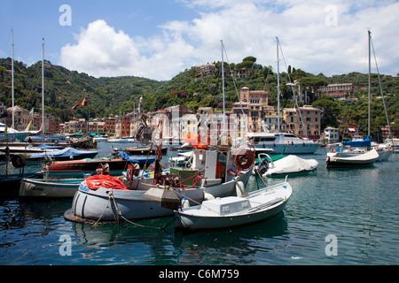 Fishing boats and yachts at harbour of picturesque fishing village Portofino, Liguria di Levante, italian riviera, - Stock Photo