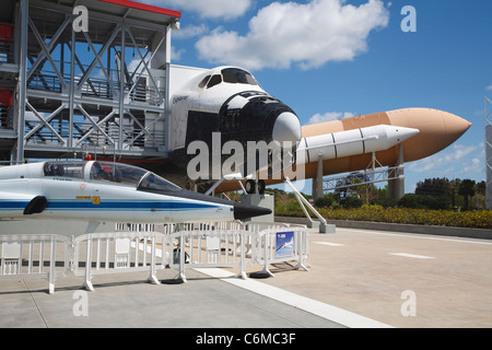Replica Space Shuttle with Northrop T-38 Talon supersonic jet in the foreground. - Stock Photo