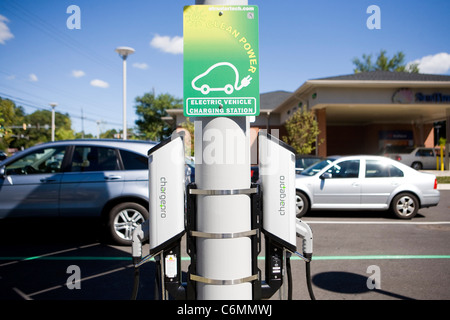 A solar powered electric car charger.  - Stock Photo
