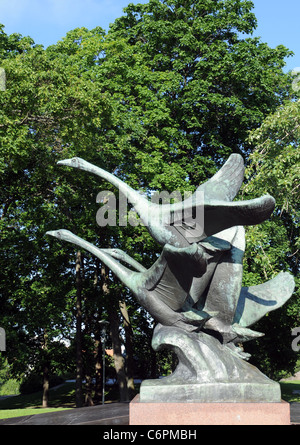 The sculpture 'Flying Swans' stand in front of the Turku Art Museum and was made by Jussi Maentynen - Stock Photo