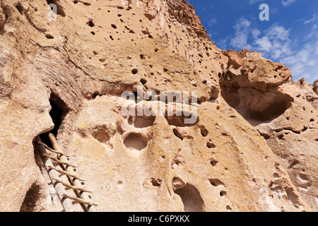 Rocky canyon wall and ladder to historic cliff dwelling - Bandelier National Monument, New Mexico, USA. - Stock Photo