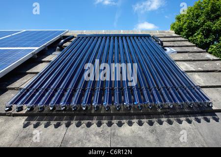 Solar Panels on a UK house - Stock Photo