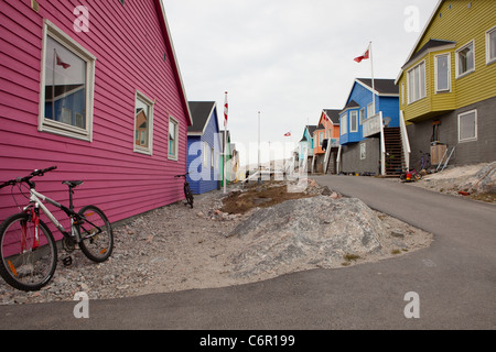 Colorful houses in Ilulissat on the west coast of Greenland - Stock Photo