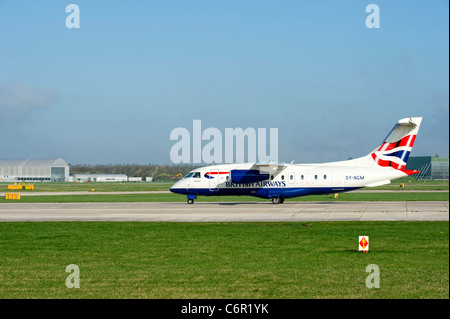 British Airways aircraft prepares for take off at Manchester Airport - Stock Photo