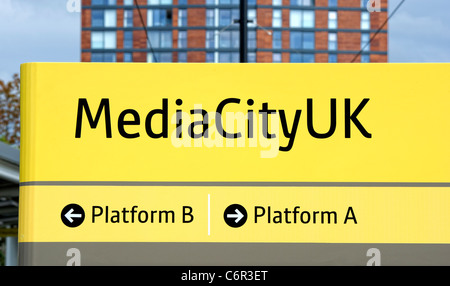 Platform signs at MediaCityUK Metrolink station (Manchester and district tram system) - Stock Photo