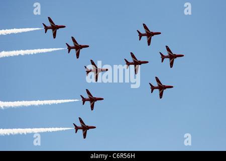 'Red Arrows' Hawk T1 jets flying in Viggen formation against blue sky, England, UK - Stock Photo