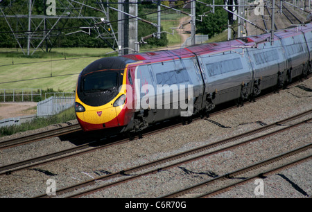 Virgin Tilting Pendolino passenger train on the West Coast Mainline in June 2011. - Stock Photo