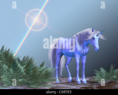 A white unicorn rests under a bright star. - Stock Photo