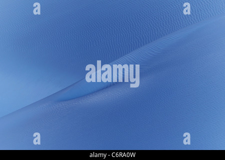 Wind Blown Sand Turned Artistic Arctic Blue Giving the Appearance of Sand or Ice. - Stock Photo