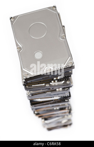 stack of hard drives on white background. Top view with selective focus. - Stock Photo