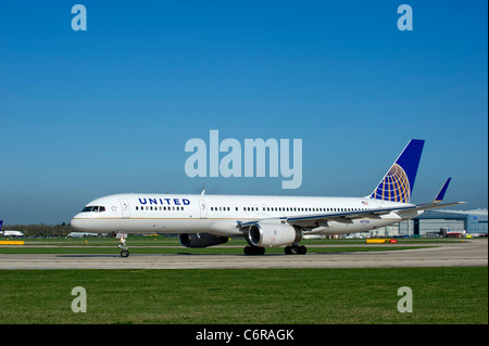 United Airlines aircraft prepares for take off from Manchester Airport, England - Stock Photo