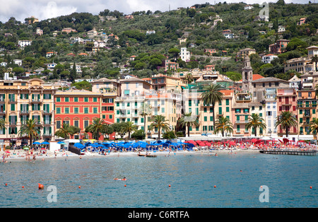 Santa Margherita Ligure, Liguria, Italy, Italian Riviera, with boats, buildings, beach and people swimming and relaxing - Stock Photo