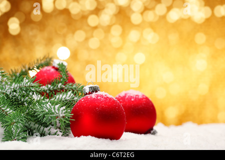 Closeup of Christmas balls with pine branch on festive background. - Stock Photo