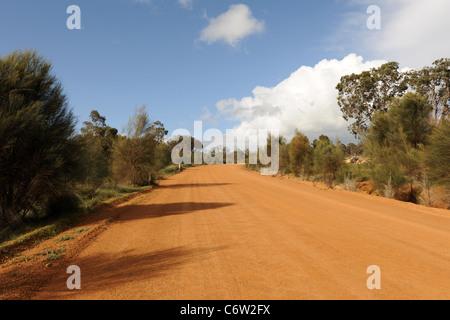 red dirt road, Beaufort Road, off Albany Highway (near Quailerup), Western Australia, Australia - Stock Photo