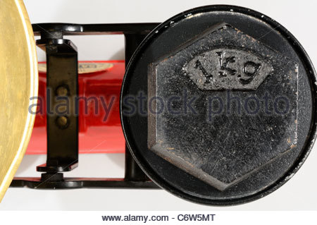 One kg Weight on kitchen scales, England - Stock Photo