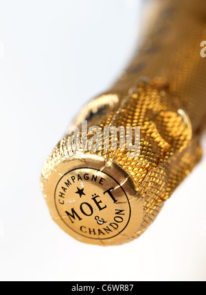 Close up of the gold foil top of an unopened bottle of Moet & Chandon, Champagne - Stock Photo