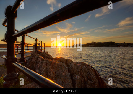 Sunset over Plymouth Hoe viewed from Mountbatten - Stock Photo