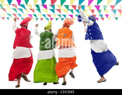 Sikh men dancing - Stock Photo