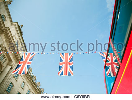 Union Jack flags hanging in London - Stock Photo