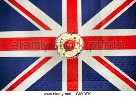 Cupcake on Union Jack napkin - Stock Photo