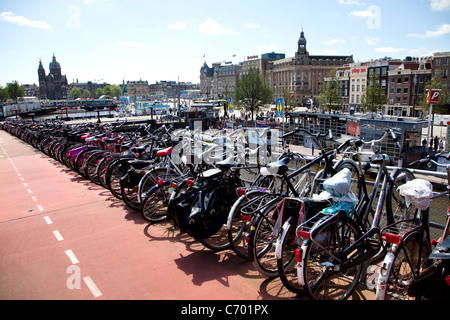 Multi-level parking for bicycles in the city of Amsterdam, The Netherlands - Stock Photo