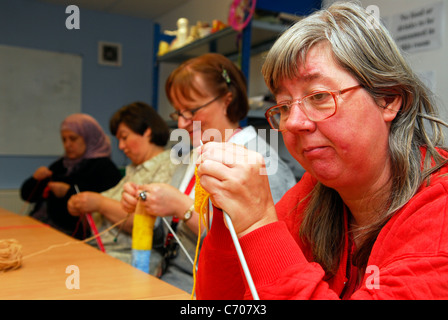 Women taking part in a knitting class for people with physical and learning difficulties, Grimsby, Lincolnshire, - Stock Photo