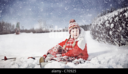 Girl putting on cross country skis - Stock Photo