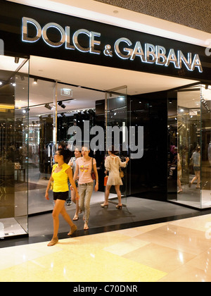Customers at the entrance to the Dolce & Gabbana store in the Ion shopping mall, Singapore Asia - Stock Photo