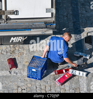 Man replacing the damaged tail lights on a lorry trailer. View from the rear behind. Close up - Stock Photo